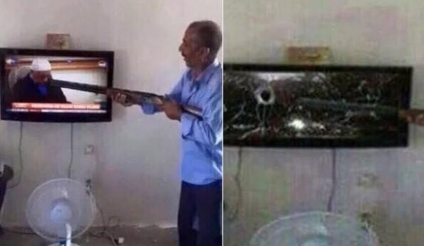 Gülen'i görünce televizyona ateş etti