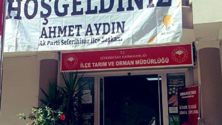 Resmi binaya asılan AKP pankartı nedeniyle görevinden alındı