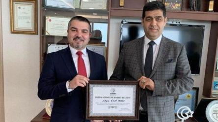 Mahkeme Başkanı Esat Toklu'ya patronlardan 'üstün hizmet ve başarı' belgesi
